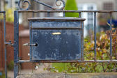 Old destroyed metal postbox — Stock Photo