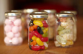 Colourful jelly beans in jar — Stock Photo