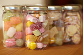 Colourful jelly mix in jars — Stock Photo