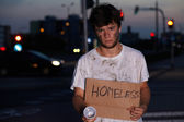 Homeless guy asking for help, sitting on a street — Stock Photo