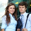 Stock Photo: Portrait of a business young couple, background