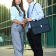 Full lenght portrait of a business young couple, background — Stock Photo