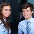 Portrait of a business young couple working together, background — Stock Photo