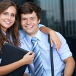 Portrait of a business young couple with briefcase, outdoor sho — Stock Photo #14250379