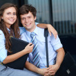 Portrait of a business young couple with briefcase, outdoor sho — Stock Photo #14250399