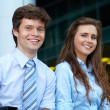Portrait of a  business young couple with briefcase, background — Stock Photo