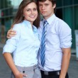 Portrait of a business young couple standing together, backgroun — Stock Photo #14251395