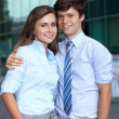 Portrait of a business young couple standing together, backgroun — Stock Photo