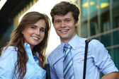 Portrait of a business young couple, background — Stock Photo