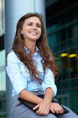Portrait of beautiful attractive businesswoman, background — Stock Photo