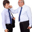 Stock Photo: Angry businessman punching young businessman, isolated on a whit
