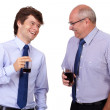 Two businessmen in blue shirts with glasses, isolated on white b — Stock Photo