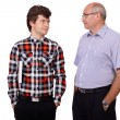 Father talking with his young son, isolated on white background — Stock Photo #14268975