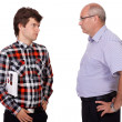 Strict father talking with his young son, isolated on white back — Stock Photo #14268981