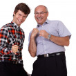 Stock Photo: Portrait of excited two guys cheering success, isolated on white