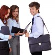 Stock Photo: Group of businesspeople standing with briefcases, isolated on w