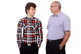 Father talking with his young son, isolated on white background — Stock Photo