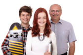Happy father with daughter and son with skateboard, isolated on — Stock Photo