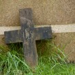 Old cross on a grass - Stock Photo