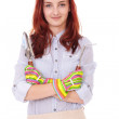 Young smiling gardening girl with shovel and gloves, isolated on — Stock Photo