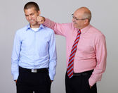 Senior businessman joke with junior businessman colleague, isola — Stock Photo