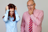 Stressed junior bussineswoman and senior businessman holding the — Stock Photo