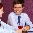 Young happy couple drink wine — 图库照片