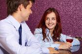Young happy couple restaurant background — Stock Photo