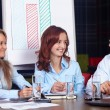 Senior businessman discuss with two young businesswomen, backgro — Stock Photo #14722859