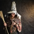 Halloween witch with hat and broom — Stock Photo