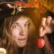 Witch with poisened apple - Stock Photo