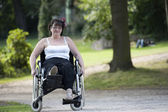 Adult woman in wheelchair , outdoors — Stock Photo