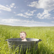 Baby in an old vintage bathrub, outdoors — Stock Photo