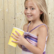 Stock Photo: Girl drinking a soda in a yellow carton cup