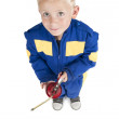 Royalty-Free Stock Photo: Boy in coverall with oil pipette