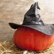 Stock Photo: Halloween witch hat on pumpkin