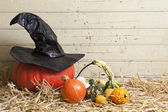 Pumpkins and witch hat — Stock Photo