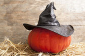 Halloween witch hat on pumpkin — Stock Photo
