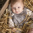 Baby in crate with straw — Stock Photo #13397768