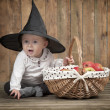 Stock Photo: Halloween baby with basket of apples