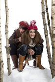 Two young women on a sledge — Stock Photo