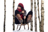 Winterfun: young woman on sledge — Stockfoto