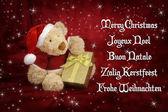 Christmas card with teddy bear — Stock Photo
