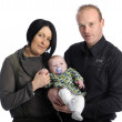 Foto Stock: Parents with baby