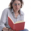 Woman with glasses reading a book — Stock Photo