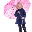 Laughing little girl under pink with dots umbrella — Stock Photo #18310135