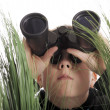 Boy with binoculars - Stock Photo