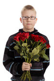 Mothers day : boy with bouquet of red roses — Stock fotografie