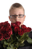 Mothers day. Boy with bouquet of red roses — Stock Photo