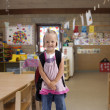 Happy little girl with backpack - Stock fotografie